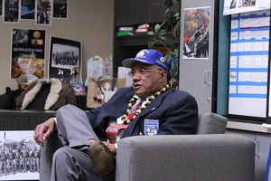 Robert Porter sitting down discussing his time as a Tuskegee Airmen.