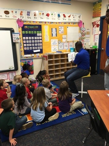 Football Players reading to us.