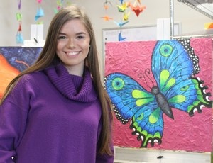 Student shows her butterfly creation