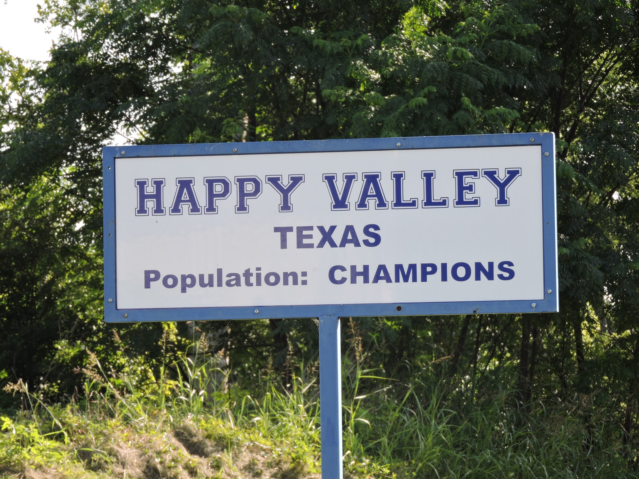 sign saying 'Happy Valley Texas' at the practice field at JHS
