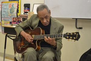 warren batiste playing the guitar