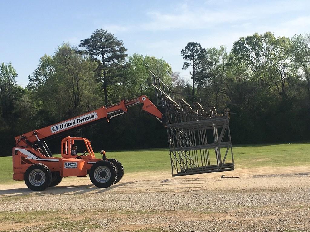 Heavy Machinery moving bleachers to the baseball/softball fields