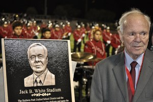 Former Baldwin Park Unified board member and mayor Jack B. White stands with a plaque that will be mounted at Jack B. White Stadium at Sierra Vista High School. The stadium was dedicated to White on Sept. 22.