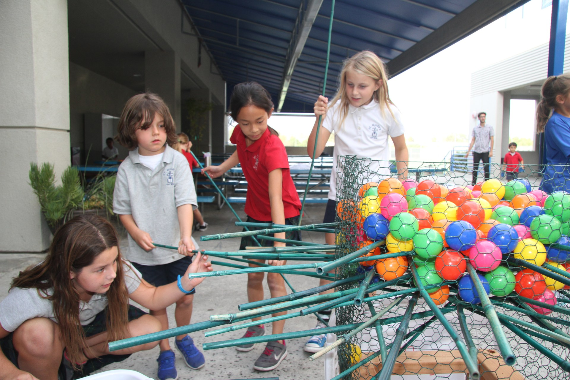 Kids playing giant Kerplunk game after school care
