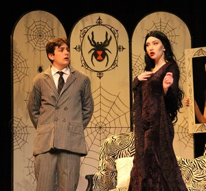 Gomez and Morticia discussing the dinner