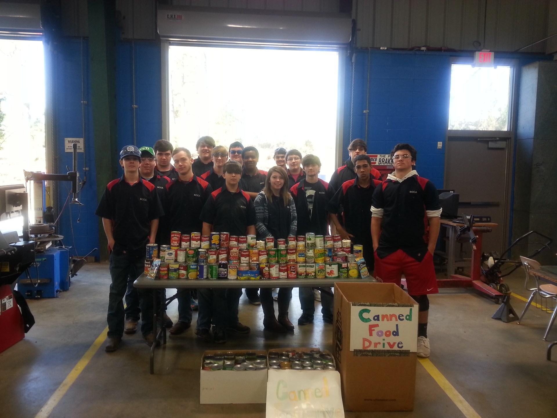 Auto students holding canned food drive.