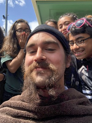 The winning class got to shave Mr. Holm's beard.