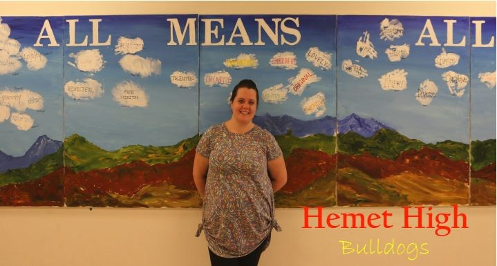 Ashley Lewis in front of a painting at Hemet High School
