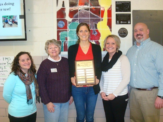Fairfield Food Pantry Trustees present plaque to FMS administrators and NJHS advisor for donating over 3,600 pounds of non-perishable foods.