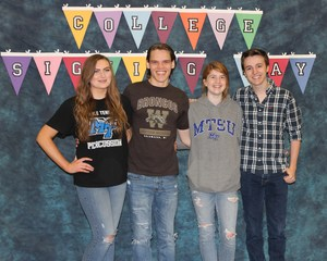 Seniors in their college t-shirts