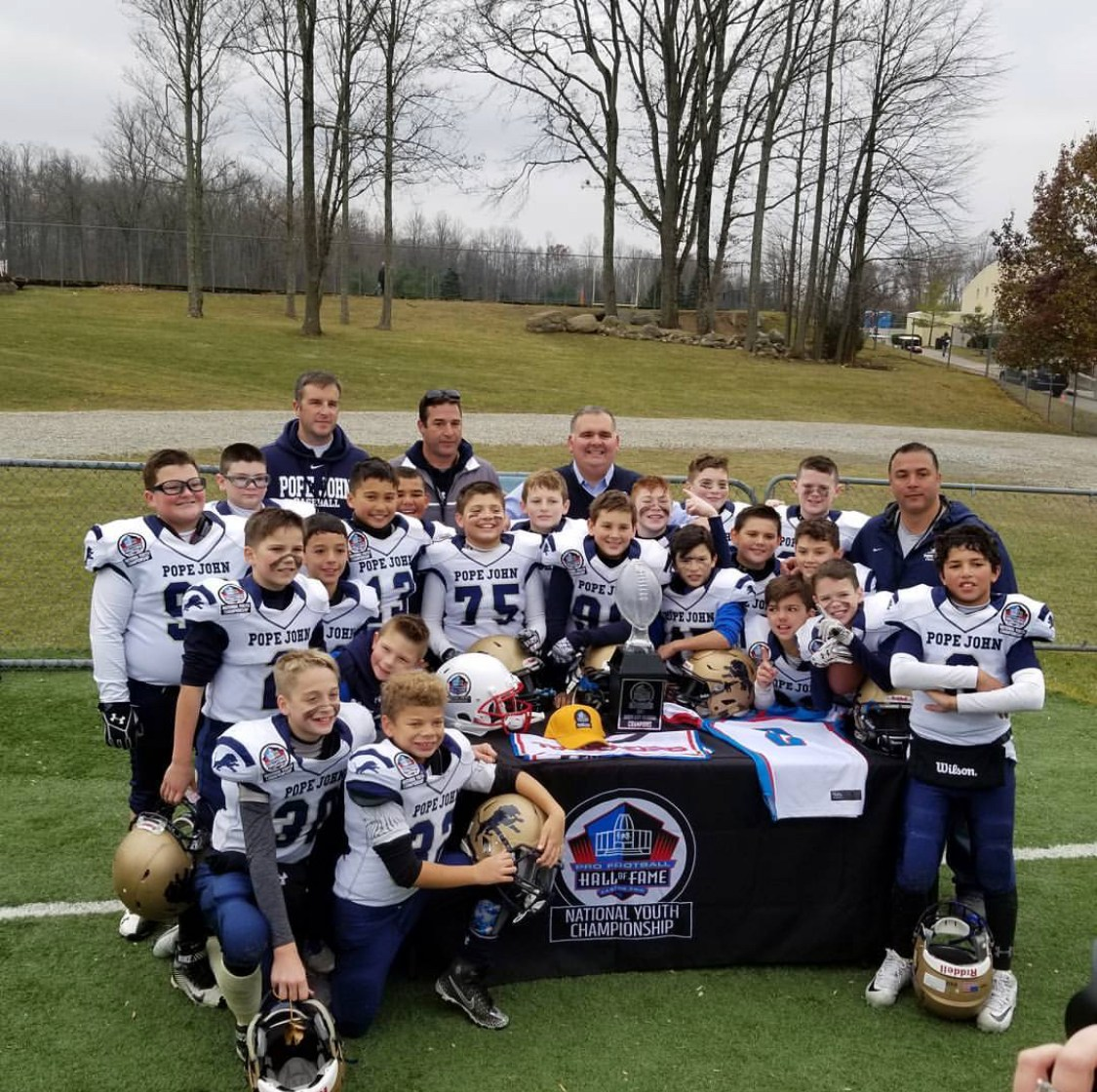 Jr Lions 10U Football team poses after winning regional championship
