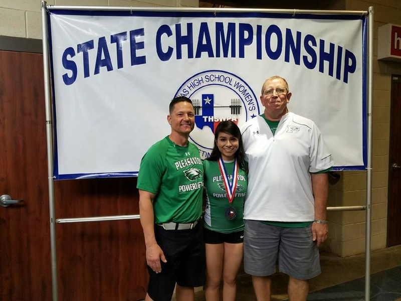 female athlete with her 2 coaches