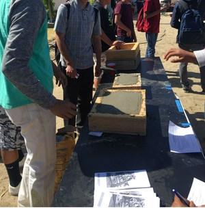 Making concrete blocks.