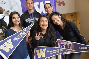 U.W. bound seniors pose for a photo with their new school gear.