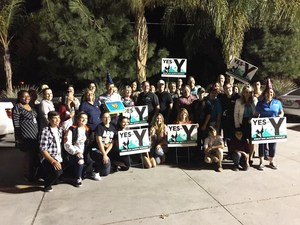 Over 30 Measure Y campaign workers gather outside their headquarters on election night to celebrate notice of preliminary success.