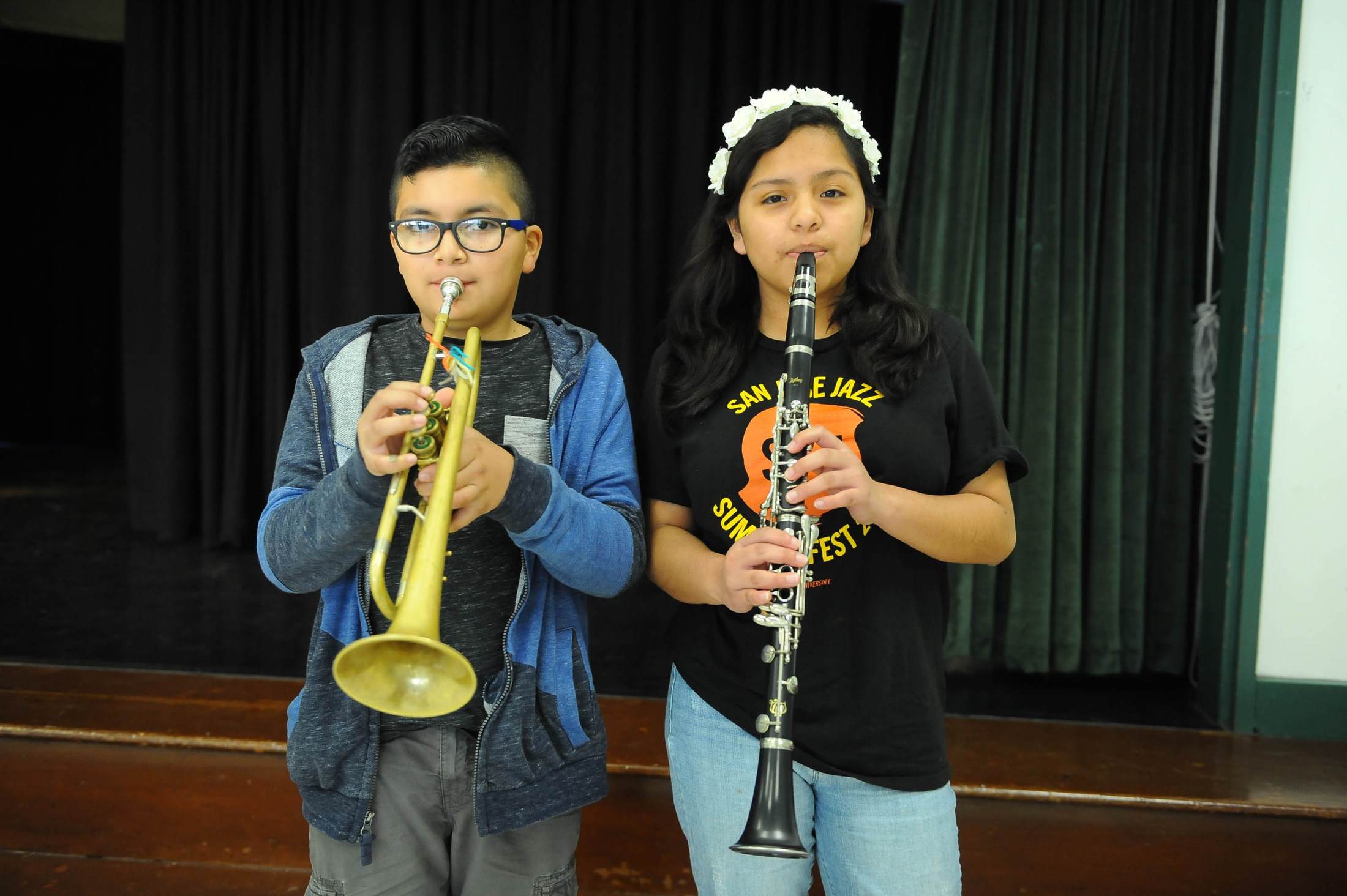students playing their clarinet and trumpet