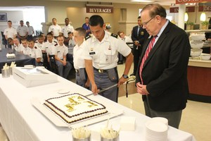 cutting general cates birthday cake