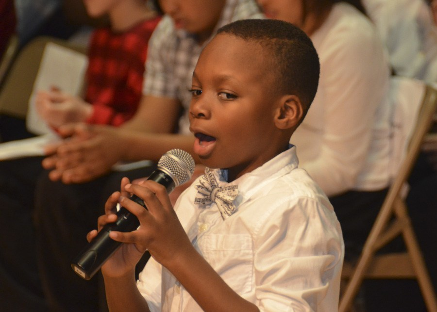 Young student singing at a concert