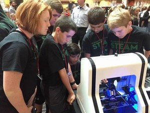JH STEAM students checking out a 3D printer at the Cities in Space Student Design Contest and Conference