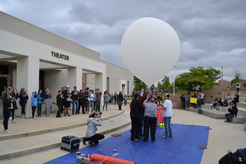 West Ranch students and staff launch high-altitude balloon into the atmosphere from the West Ranch campus