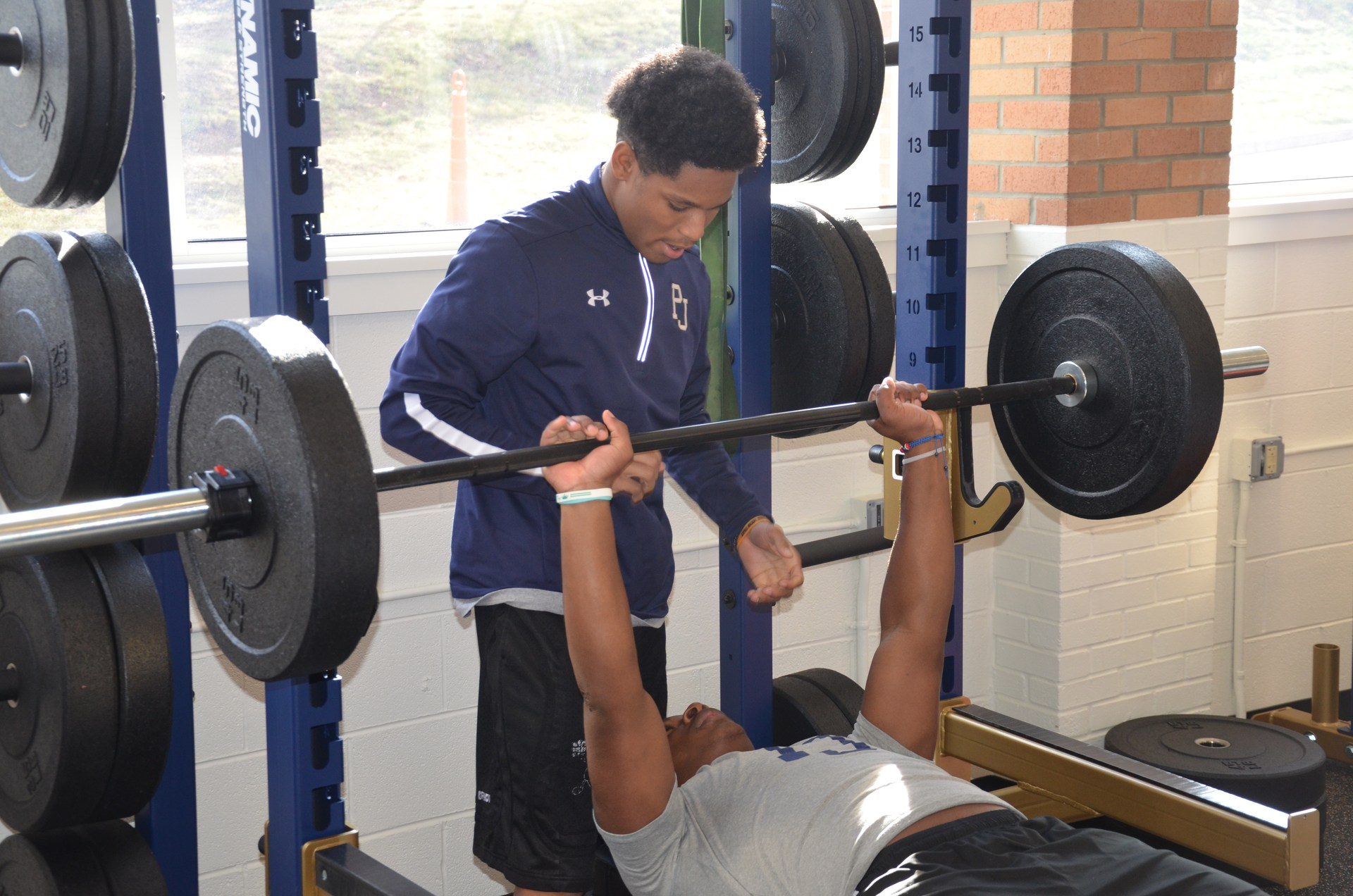 Two student athletes working out in Coach Paternostro Training Center