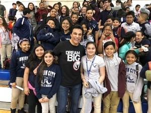 Marc Mero standing with Emerson Students