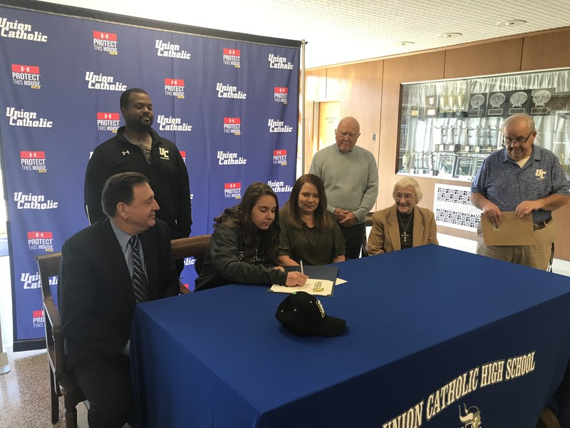 UC's Kaitlyn Lowey signed her National Letter of Intent with Felician University on Friday Thumbnail Image