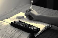 Student writing and a calculator