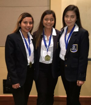 group of three students advancing to state DECA competition