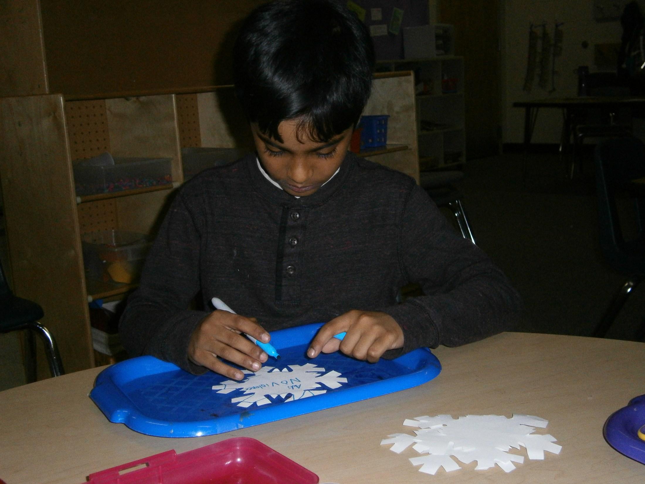 Writing on a snowflake.