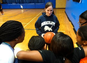 IC Coach Anne Lauterhahn with girls page two.jpg