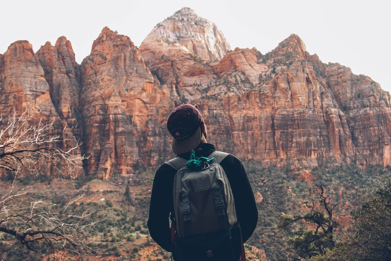 Teenager outside in the desert.