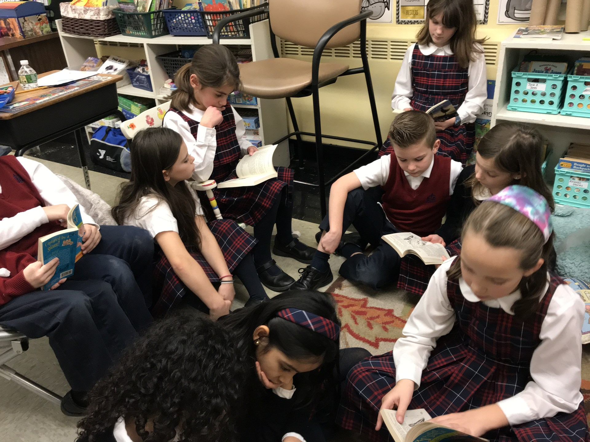 Group of students read together