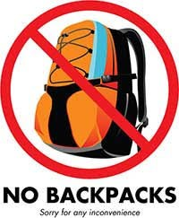 Back pack with a sign over the top meaning no back packs allowed.