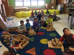 Students enjoy problem solving as they build with blocks together.