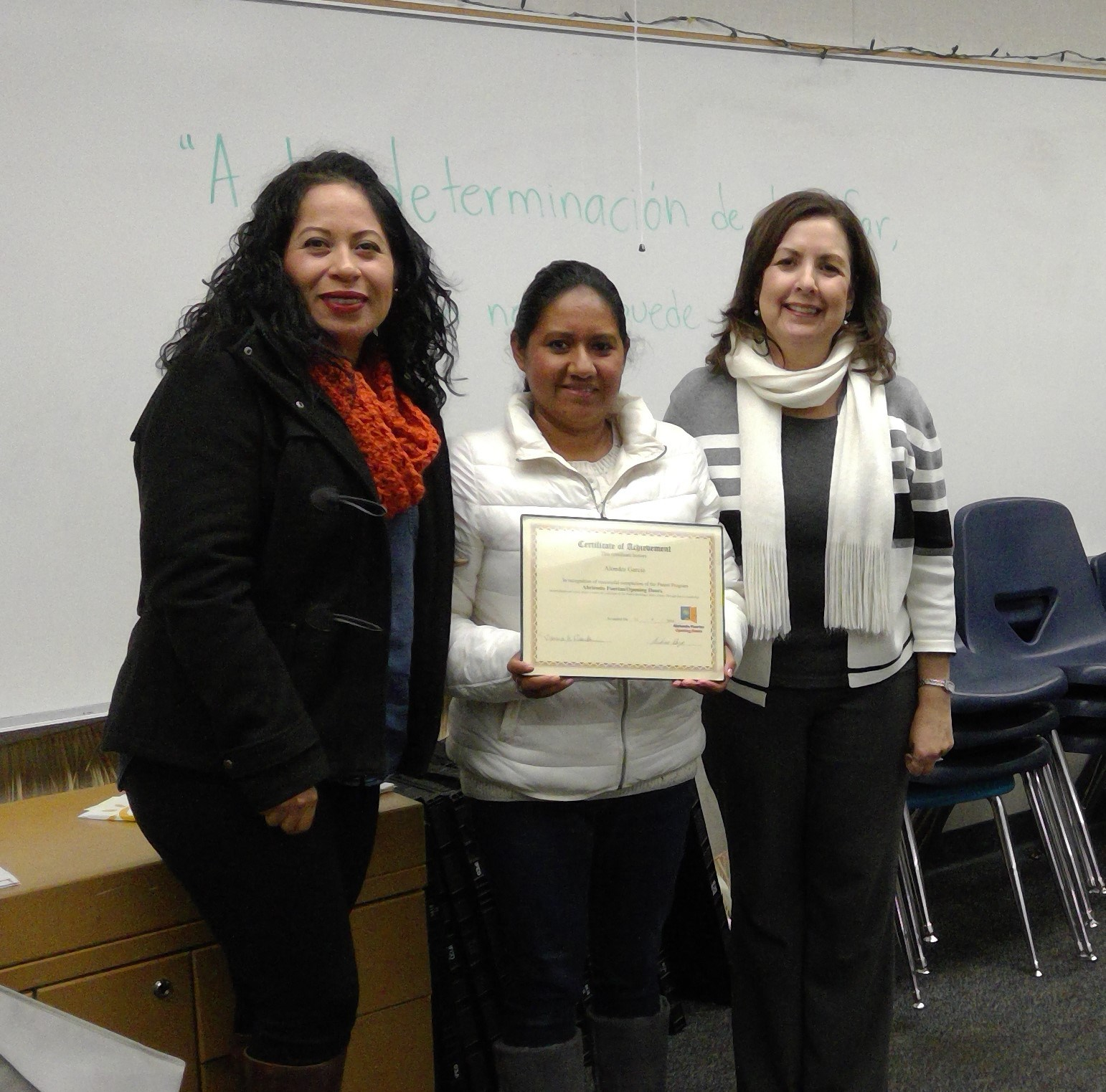 parent receiving completion award with class instructors