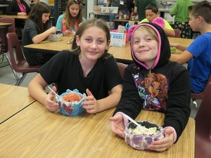 Ali Bolt and Faylene Guy enjoy their ice cream treats and admire their bowls.