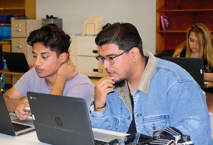 BPUSD_ILC_2: Miguel Solis (right), a senior at Baldwin Park High School, enrolled in the Independent Learning Center (ILC) during the summer and has since excelled with the opportunity to access online courses from home or school, and progress toward graduation at his own pace. ILC provides a rigorous, online curriculum with flexible hours and the opportunity for students to participate in traditional school activities.