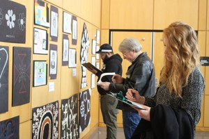 Judges studying artwork
