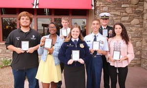 Zack Weir, DeLauren Grant, Sean Garrett, Mariah Harper, Gabriel Ambriz, Andrew Weishaar, and Nathaly Avalos posing with their Student of the Month plaques