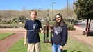 Tanner Packham and Krystal Horton holding their Science Fair trophy.