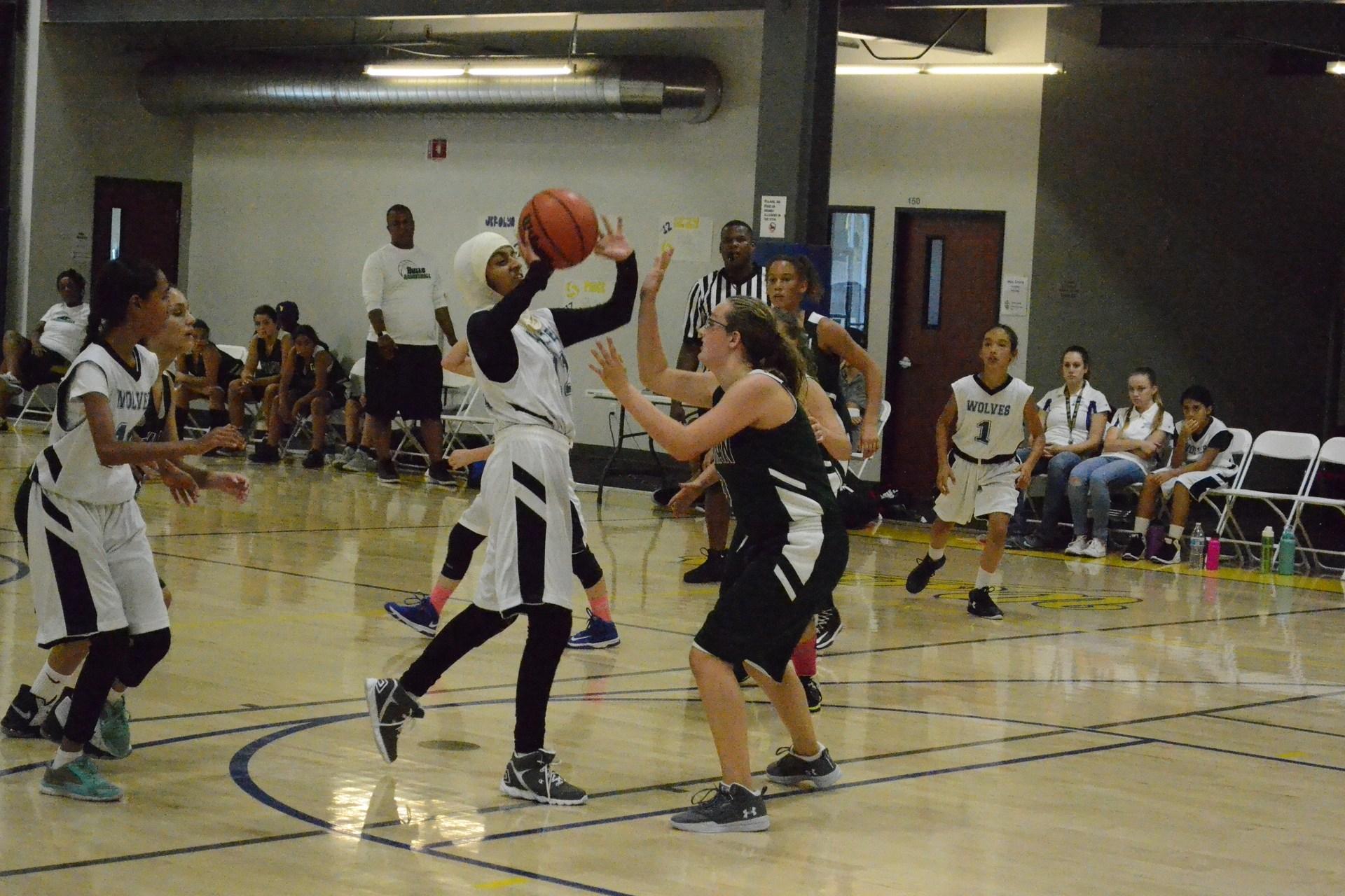 player shooting basket