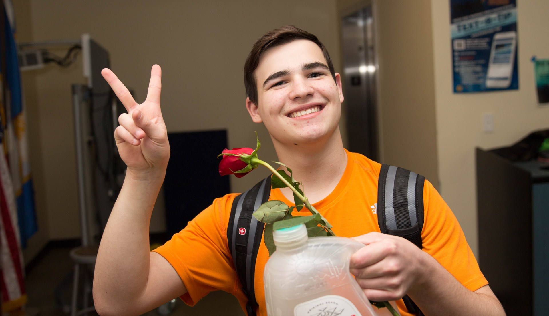 high school student with a rose