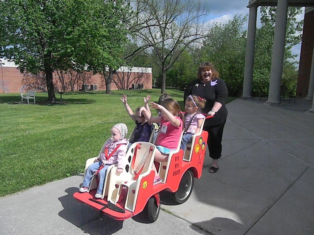 Mrs. Ressie with a cart full of kids!