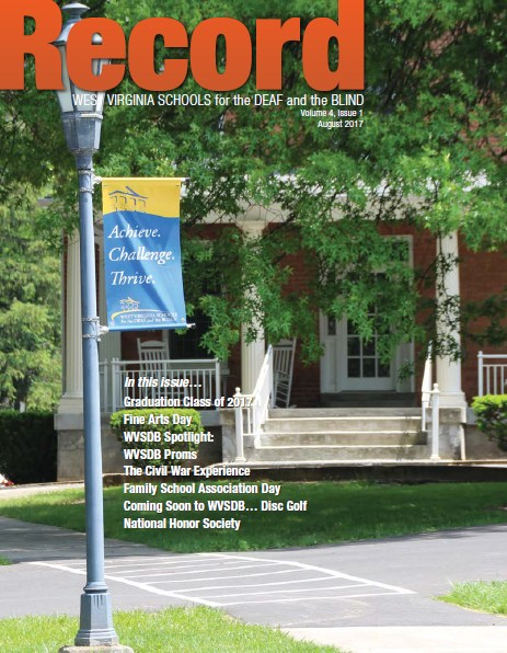 """August 2017 Record Cover showing Administration building with new """"Achieve. Challenge. Thrive."""" banner on lightpost"""