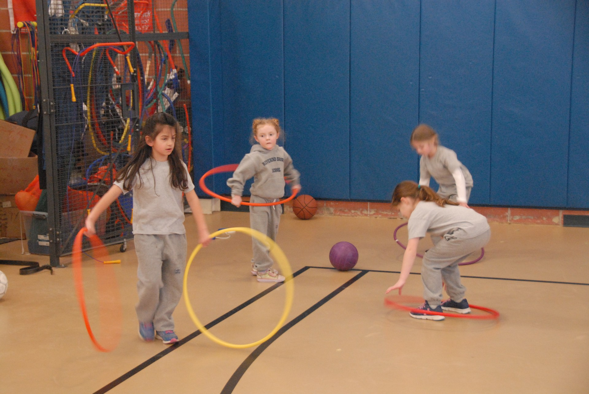 Students practice with hula hoops