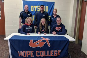 Maddie with her parents, coaches and athletic director.