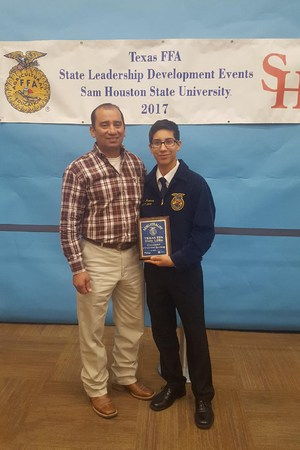 Pictured are Ruben Alaniz, VMHS FFA teacher, and JR Martinez, FFA member.