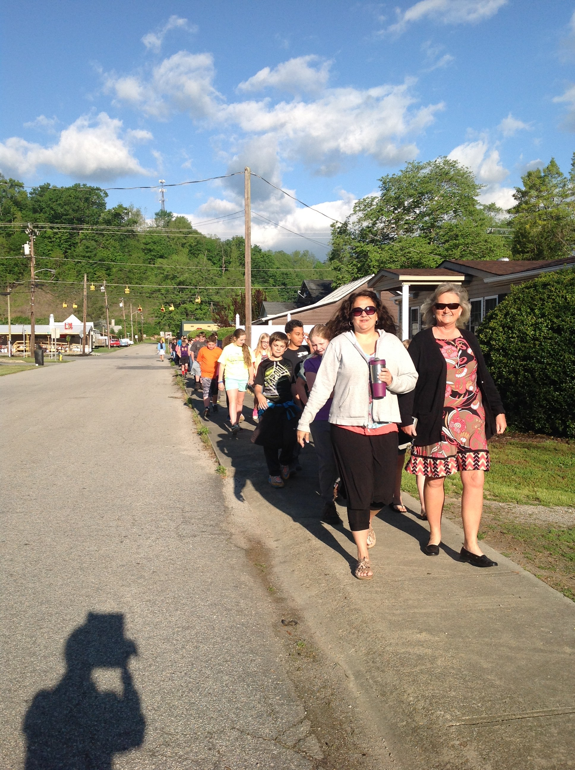 Mrs. Dyer and her students walking down the road.