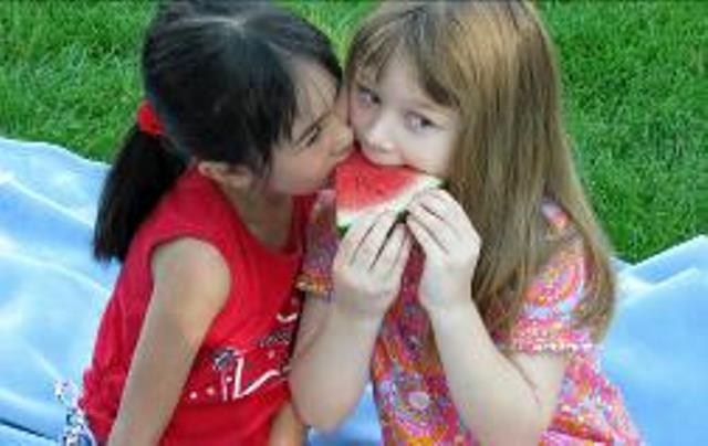 Campers eating watermelon